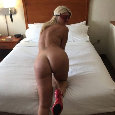 Blonde housewife shows her juicy ass. Hot MILF frees her amazing body from see thru lingerie in matching mask