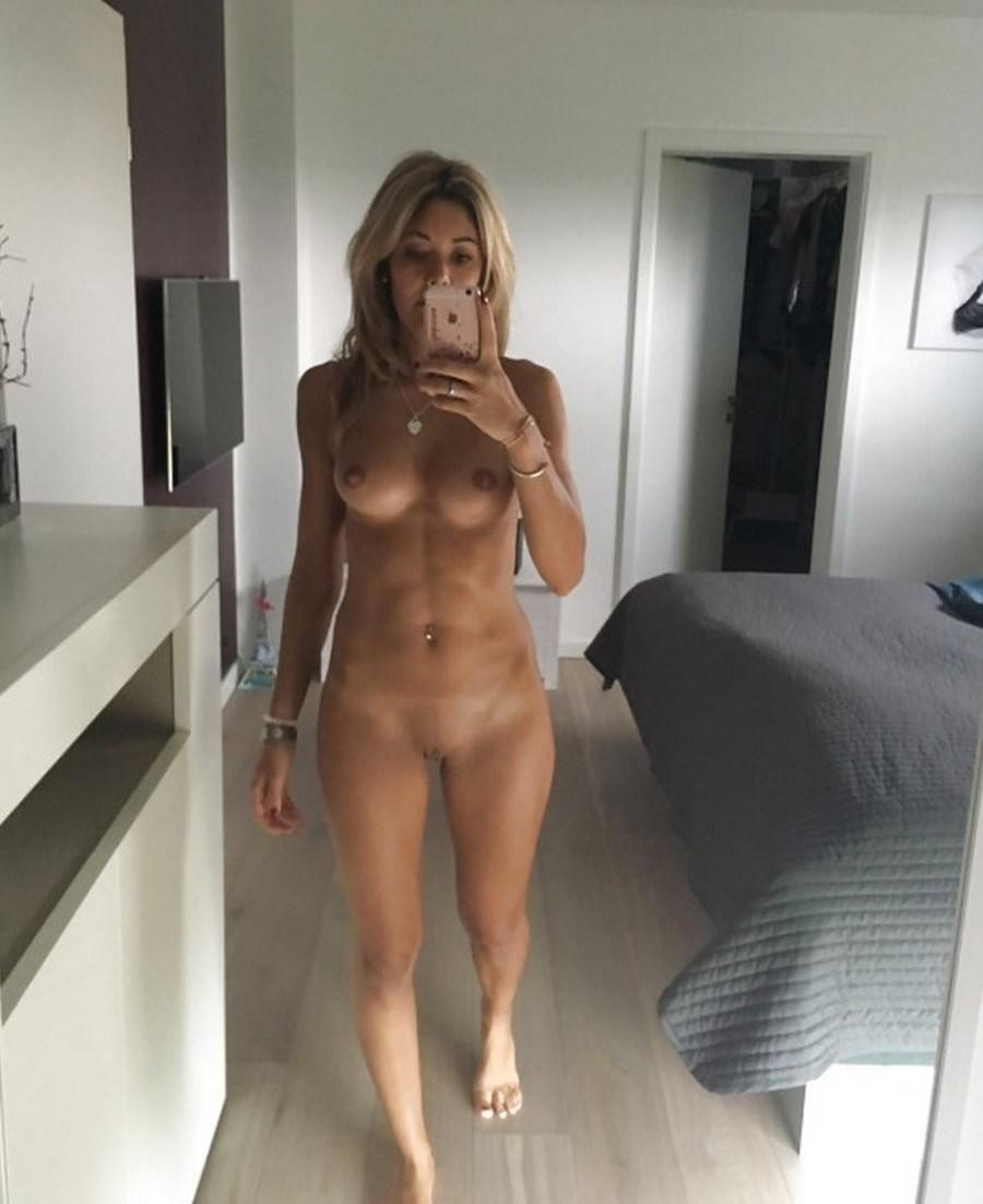 Amateur hottie MILF reveals her small tits and shaved pussy. Blonde Mature amateur removes her bra while taking mirror self shot