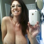 Glasses mature takes nude selfie of her huge breasts