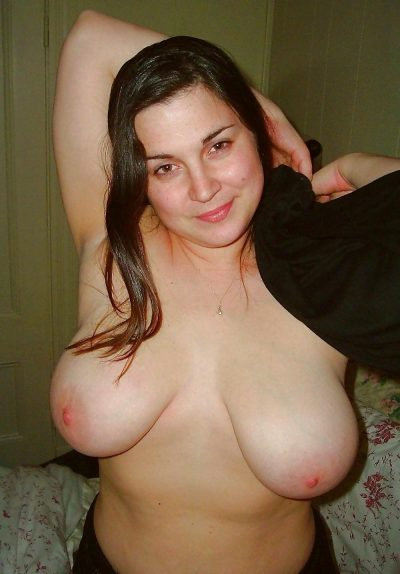 Busty Mature brunette strips her dress and displays nice curves. Amateur wife removes her outfit and shows her great big tits
