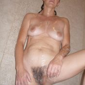Mature uncovers hairy pussy in the shower