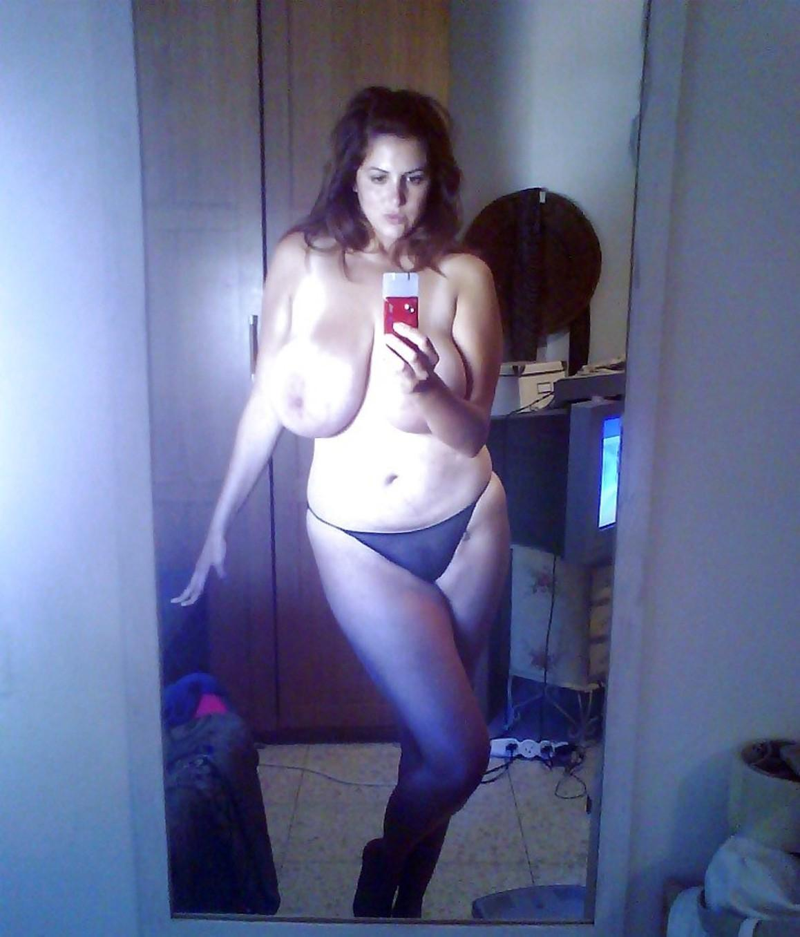 Mature lady with big natural can awaken men's senses. Brunette MILF with black hair uncovers her nice melons
