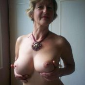 Amateur granny showing her big natural titties