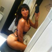 Big titted MILF takes self shot