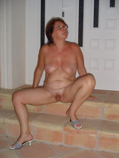 Mature woman stripping and fisting her muff on stairs. Redhead wife spreads naked on the stairs in front of the door of the house
