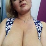 Russian Milf uncorks her hooters as she strips naked. Mature lady enjoys showing off her big tits