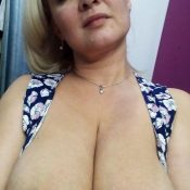 Russian Milf enjoys showing off her big tits