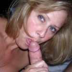 MILF amature sucking and jerking a hard cock. Blonde MILF gives a perfect blowjob in porn image