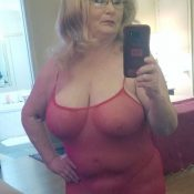 Older granny takes nude self shot in bedroom mirror