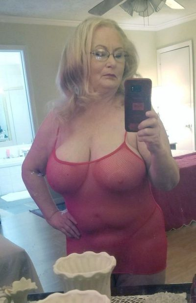 Older granny in lacey lingerie takes a self shot of her enticing great saggy tits. Old lady takes nude self shot in bedroom mirror