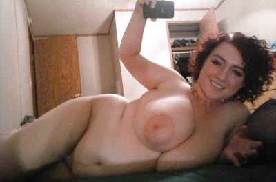 MILF chubby with big tits exposed takes naked selfies at home. Amateur wife bares her big floppy tits & takes a homemade selfie