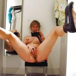 Amateur wife takes nude selfies in a full-length mirror. MILF female snaps selfie while she fools around with her hairy pussy