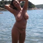Nude Italian MILF shing natural breasts at beach. Busty woman lady showing off big tits outdoor on beach