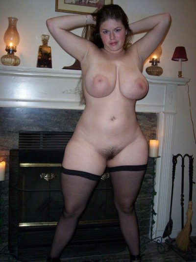 Chubby 30 plus MILF delights in showing off her nude body. Middle aged women uncovers big naturals as she strips naked