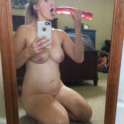 Mom sucks on her vibrator while taking selfie