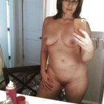 Mature Woman shows off her boobs and nude pussy in selfie shot. Beauty old wife takes self shot while posing nude