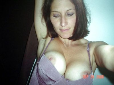 Amateur MILF flashing firm tits. Nude wife with pretty face stripping and picturing herself. Brunette Mature women releasing nice huge boobs from bra