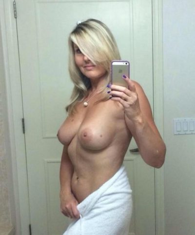Nude Cougar blonde taking topless selfshot in mirror. Wife with perfect boobs undressing for sexy photo. Amateur MILF takes naked bathroom selfie in mirror