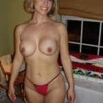 Blonde cougar takes her clothes off and shows remarkable curves. Blonde MILF with killer curves exposes big nipples
