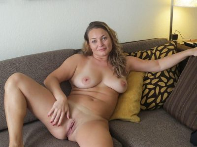 Wonderful Milf displays her wide open pussy after undressing. Amateur natural titted wife shows her amazing hot body lying on the bed