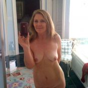 Older milf nude selfie in a mirror