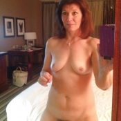Mature women takes nude selfie of her small tits
