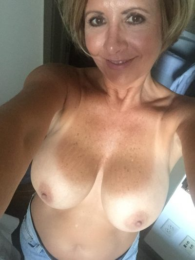Older mature wife takes self shot while getting undressed. Real mom with a pretty face takes naked selfie of her big natural tits