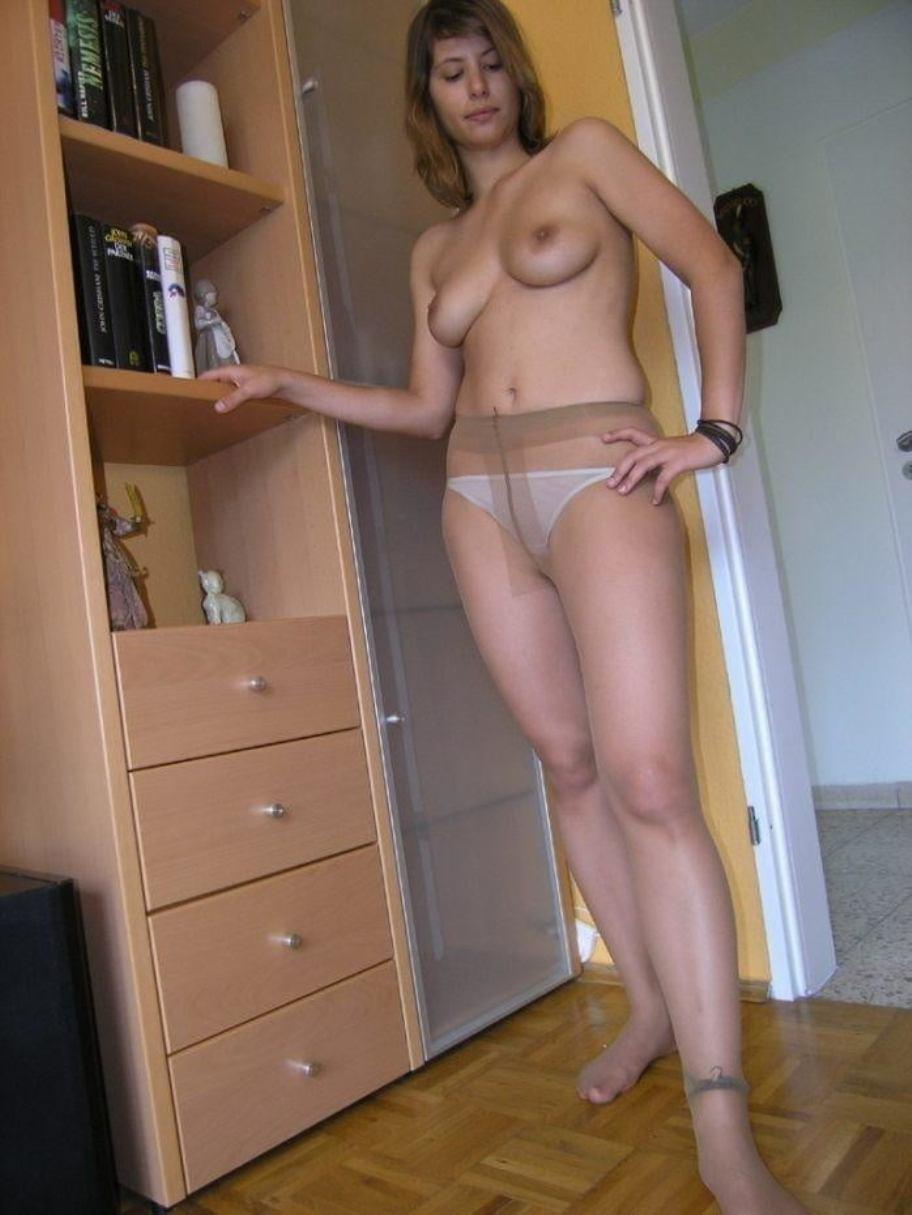 Nude MILF in pantyhose exposes her boobs. Hot Housewive is showing her natural titties in pantyhose
