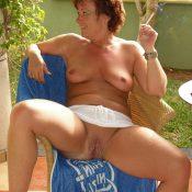 Redhead mom spreads her pierced pussy