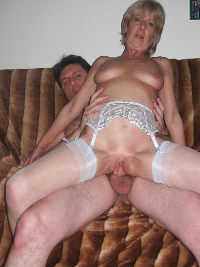 Mature blonde in stockings jumps on top of a hard cock. Wild old mom rides a fat cock for privat porno picture