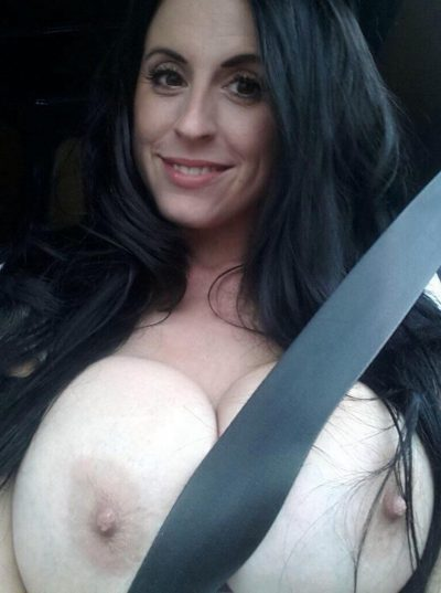 Stunning MILF flashing seatbelt boobs during self shot. Busty brunette women uncovering her big tits sitting in the car