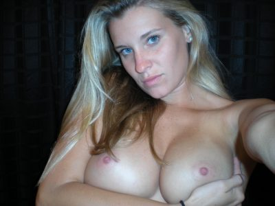 Hot selfie shot of Amateur MILF bubble boobs and her big hard nipples. Busty lady exposing her perfect boobs and picturing herself