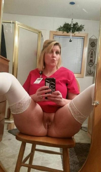 Blonde mom baring nice twat while taking selfie in mirror. Naughty mature female taking nsfw selfie of shaved pussy