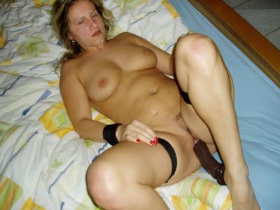 Wild amateur wife drives big dildo into her horny pussy. Mature housewife masturbating toy her old cunt on the bed