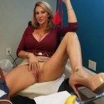 Beauty old lady taking her panties off in the office during a break. Sexy beautiful MILF woman taking off her thongs panties