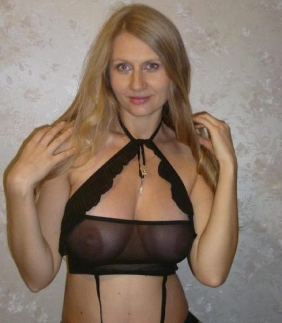 Busty beauty Milf teasing with her big tits in lace lingerie. Sexy blonde wife poses in black lace bra and matched panty ensemble