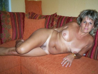 Russian mature slowly uncovering her gorgeous curves. Naughty housewive flashes her natural bosoms and hairy pussy
