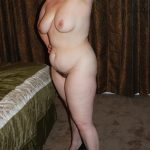 Curvy mature women unveils saggy tits and hairy pussy in the bedroom. Chubby wife shows her curvy body posing only in high heels