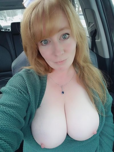 Blonde MILF flashing boobs during self shot. Stunning old babe uncovering her big tits in the front seat of the car