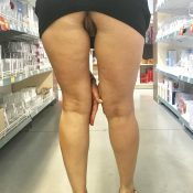 Mature women flashes no panty upskirt inside a shop