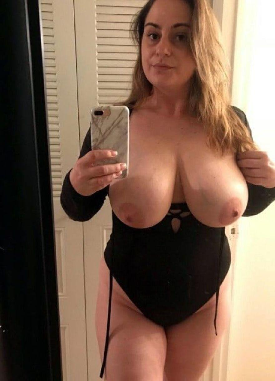 Amature mature women takes nude selfie in the mirror. Sexy blonde MILF bares her big boobs during self shot action in front of the mirror