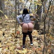Mommy takes off her panties in the forest