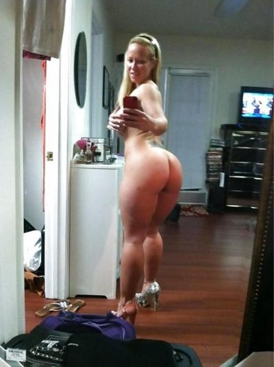 Pretty blonde Wifey enjoys showing off her bare ass. Taking some self shot photo of myself in the mirror baring my juicy ass for you