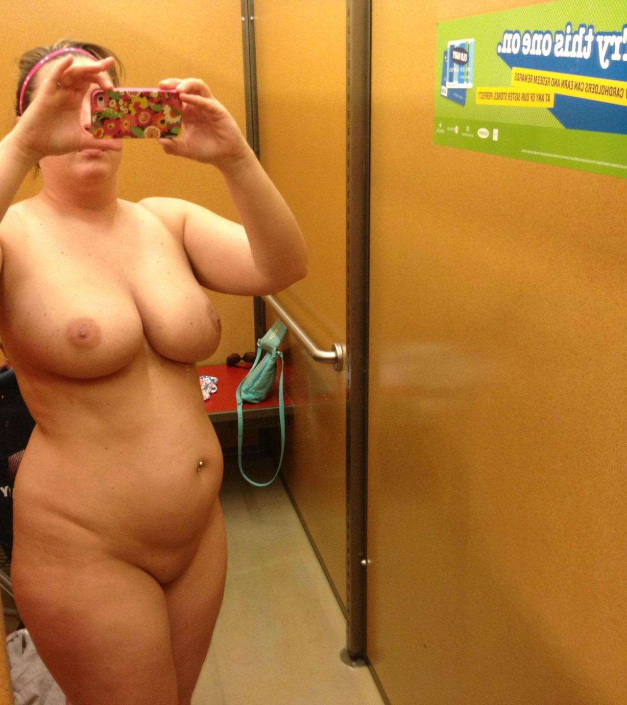 Chubby mature does sexy self shot while naked in changing room. Amateur fat wife bares her big boobs during self shot in dressing room