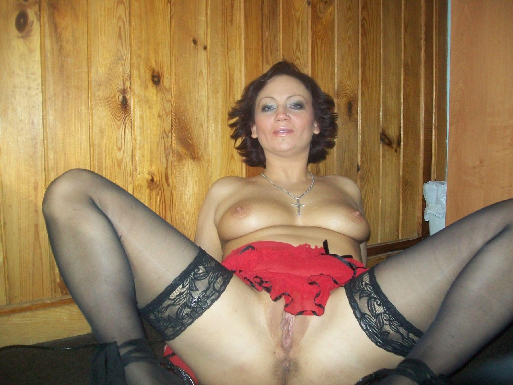 Nude Polish MILF bares shaved vagina spreading naked on the floor. Mature lady in black stockings shows her pussy lying on the floor
