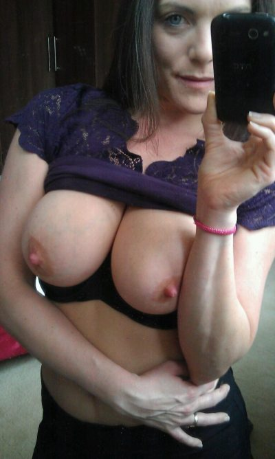 Real MILF bares her big boobs during self shot action. Sexy brunette mom removes her bra for nude self shot