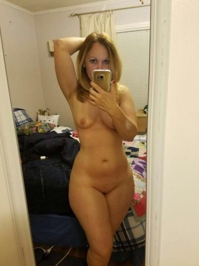 Beauty blonde MILF takes nude selfie while she exposes her horny body. Naked blonde wife shows off her perfect body for the camera