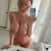 Big Tits MILF take naked bathroom selfie in mirror