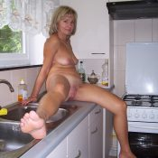 Amateur MILF naked posing in the kitchen
