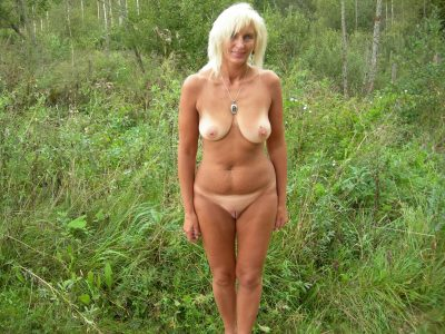 Hot blonde MILF takes off bra and panties in outdoor. Beautiful wife strips naked for an outdoor